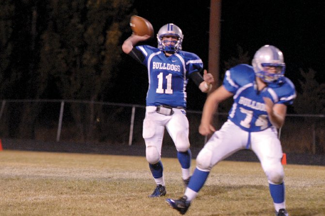 Bubba Ivers, a Moffat County High School junior, looks to throw the ball downfield Friday against Battle Mountain High School at the Bulldog Proving Grounds. The MCHS varsity football team contained the Huskies offense, but couldn't finish their own offensive drives in a 28-13 defeat.