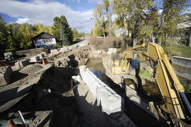 City workers this week were working to stabilize the banks along Soda Creek on the north side of Lincoln Avenue.
