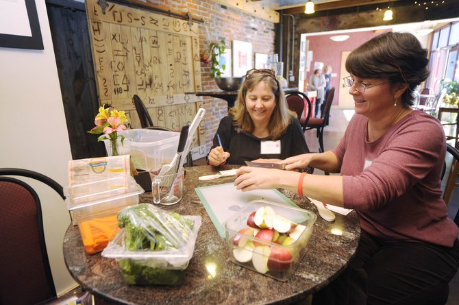 Sisters Tammy Innes, right, and Cherie Pitman cut apples during a Sisters in Steamboat cooking class at City Cafe at the 2011 event.