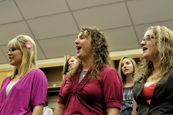 From left, Moffat County High School students Kyla Warne, Kaitlen Bird and Jordyn Caddy practice in Heather Dahlberg's choir class Tuesday afternoon at the high school. CenterStage, the MCHS varsity choir, is vying for up to $50,000 in the GLEE Give A Note contest, which is partially vote driven and provides grants to music programs in need across the country.