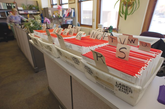 Returned ballots are stored alphabetically in the Clerk and Recorder's Office at the Routt County Courthouse. The ballots have been returned because people have moved or changed addresses without notifying the office. Voters who have not received their ballots should call the Clerk and Recorder's Office at 970-870-5556.