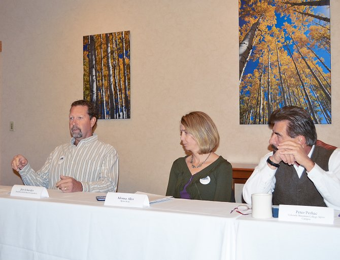 Jim Schneider, Steamboat Ski & Resort Corp.'s vice president of skier services, discusses the prospects for the coming ski season Wednesday during the Steamboat Springs Chamber Resort Association's Business Outlook Breakfast. Joining him are Adonna Allen, president of Alpine Bank in Steamboat Springs, and Peter Perhac, chief executive officer of Colorado Mountain College's Alpine Campus.