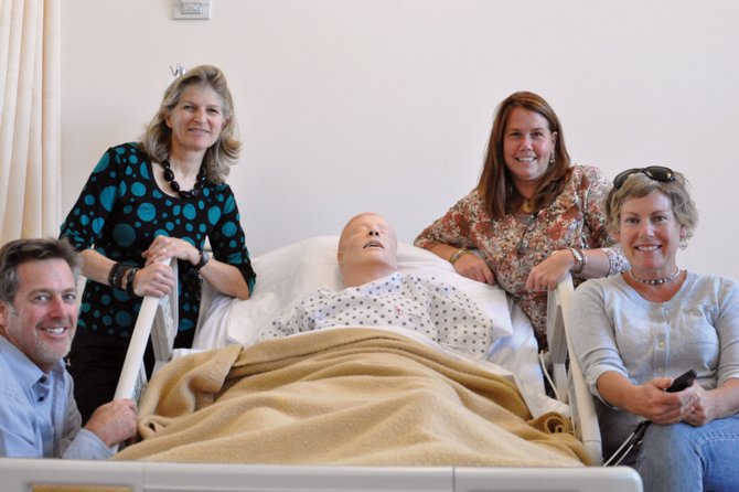 Shown above, from left, are Colorado Northwestern Community College nursing student Jim Earley, nursing faculty member Julie Alkema, nursing program director Kelly Martin-Puleo, and nursing student Josie Dean who pose near a training dummy in the Craig campus' academic building Tuesday. The nursing program is seeking accreditation through the National League for Nursing Accrediting Commission, a step that Martin-Puleo said will make it easier for students to transition into higher degree programs at other institutions.