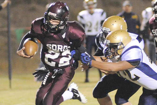 Soroco quarterback Nic Paxton pulls away from a defender Friday night against North Park. Paxton rushed for three touchdowns and threw for two more, leading the Rams by the Wildcats, 37-0.