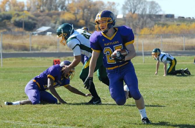 Daniel Wille, a Little Snake River Valley School senior, breaks loose during the first quarter Friday against Farson-Eden High School in Baggs, Wyo. Wille ran for two touchdowns and returned an interception for another in a 63-30 victory over the Pronghorns.