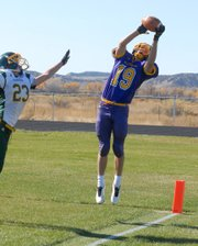 Rex Stanley, a Little Snake River Valley School senior, brings down a pass Friday against Farson-Eden High School in Baggs, Wyo. The Rattlers finished the regular season 8-0 and will host a first-round playoff game next week in Baggs.