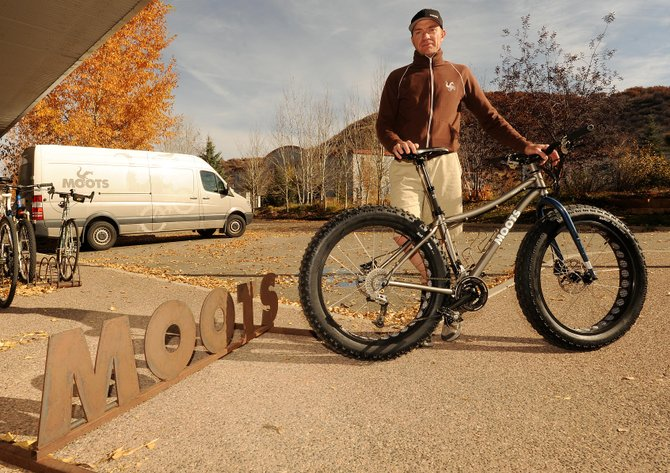 "Moots' Jon Cariveau shows off the company's new snow bike. This will be the bike's first year in production, but previous versions have been built for employees and for custom orders. Some of those models were called ""Snoots,"" but the new version will go by ""FrosTi"", playing on the bike's titanium frame."