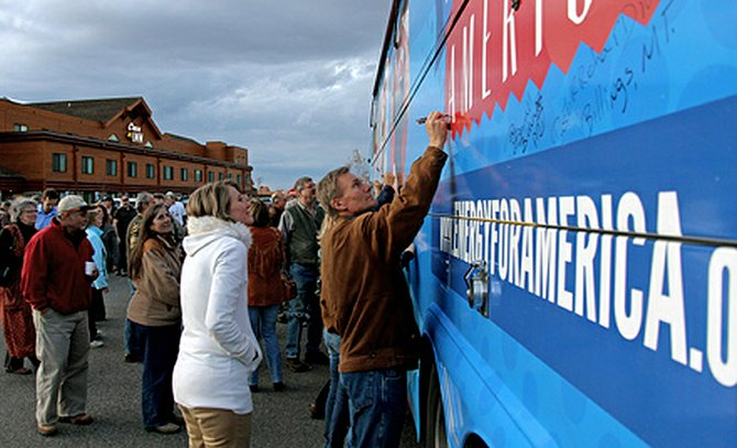 Energy activists in Billings, Mont., sign the Energy for America tour bus during a rally Oct. 20. The signed tour bus serves as a rolling symbol that Americans are in favor of responsible natural resource development and the jobs that come with it. The Energy for America tour and rally will be rolling through Craig at 6 p.m. Tuesday at the Moffat County Fairgrounds Pavilion, 750 E. Fourth St.