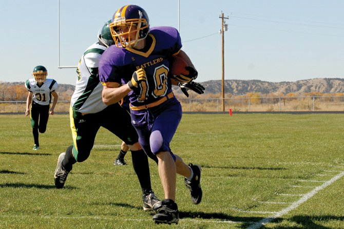 Cole Gourlay, a Little Snake River Valley School junior, returns an interception down the sideline Oct. 21 against Farson-Eden High School in Baggs, Wyo. Head coach Mike Bates said Gourlay and fellow junior Manuel Quinteros will be key in stopping Hulett High School's offense Friday in the first round of the Wyoming 1A state playoffs.