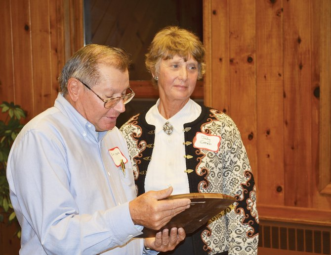 Judy Green, of rural Hayden, receives the Leckenby Pioneer Award on Monday night from Jim Stanko, of the Leckenby and Larson Awards Committee associated with the Tread of Pioneers Museum.