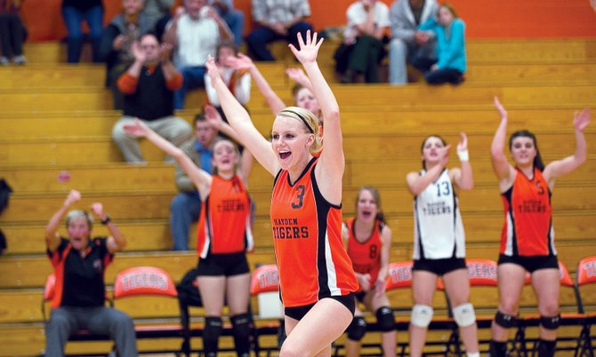 Hayden's Jacie Temple celebrates after the Hayden Tigers scored a point in the second game of Tuesday's district playoff match against West Grand. Hayden won, 3-1.