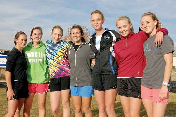 Moffat County High School girls varsity cross-country runners will use their strong finishes to try and place high as a team today in the 4A state meet at the Arapahoe County Fairgrounds. From left, are Katharine Keiss, Aubrey Campbell, Savannah Williams, Kelly Ciesco, Bailey Hellander, Sassy Murray and Eryn Leonard.