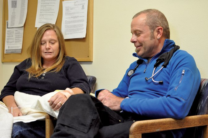 Dr. Joel Miller, D.O., talks with patient Teresa Hinkson, 47, of Craig, on Friday afternoon at High Country Medical, 535 Yampa Ave. Moffat and Rio Blanco counties are designated as health professional shortage areas for primary care physicians, meaning residents have limited access to doctors who specialize in fields like family practice, pediatrics and internal medicine.