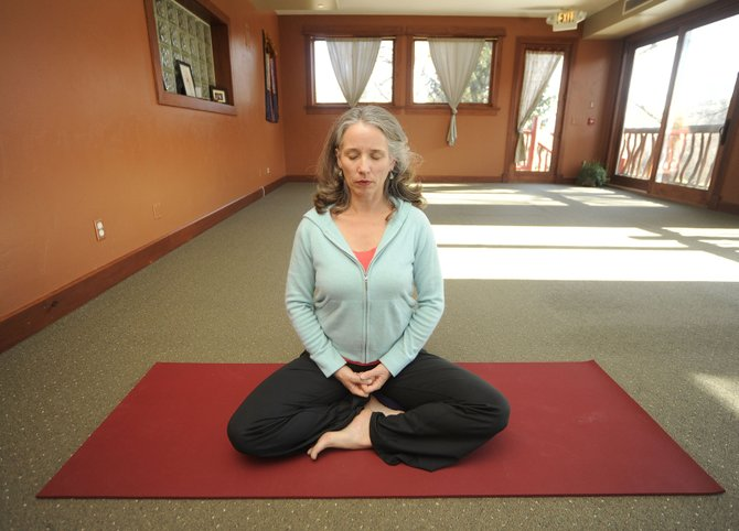 Nina Darlington, who was diagnosed with breast cancer 11 years ago, now teaches a yoga class for other cancer survivors.