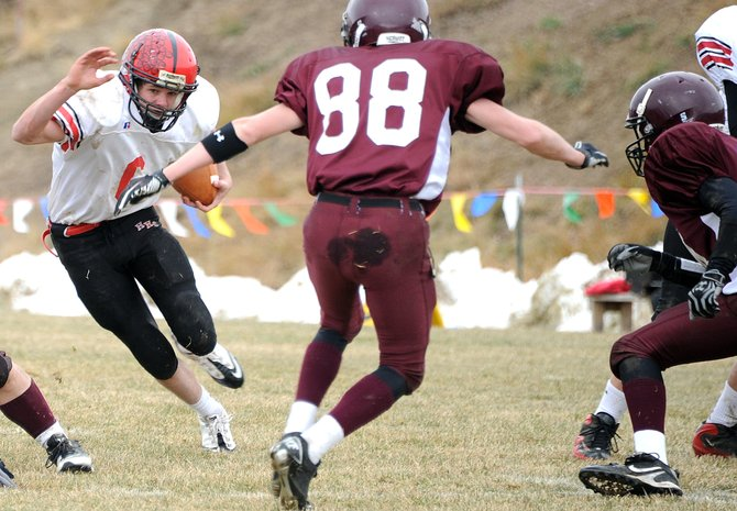 Haxtun junior running back Ryan Nelson cuts through the Soroco defense Saturday. The Bulldogs ran big and early on the Rams, racking up a big win in the 8-man cross-divisional football game.