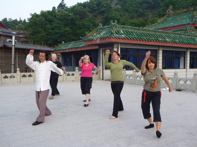 Sarah Braat, second from right, practices a Qigong movement on Wu Dang Mountain in China.
