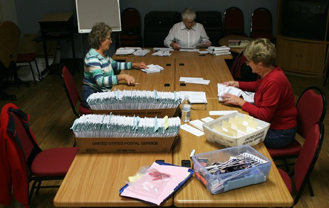 Election judges, from left, Linda Riley, Jerrie Simpson and Judy Smith sort ballots Tuesday afternoon at the Moffat County Courthouse. Local voters elected J.B. Chapman, Sherry St. Louis and incumbent Tony St. John to the Moffat County School Board and voted down the statewide Proposition 103 by 76 percent.