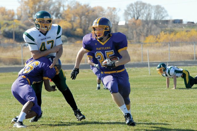 Daniel Wille, a Little Snake River Valley School senior, runs down the field Oct. 21 in Baggs, Wyo., in the Rattlers' regular-season finale. LSRV hosts Kaycee High School on Friday in the Wyoming 1A six-man football state playoffs. The Rattlers beat Kaycee 66-6 on Oct. 7.
