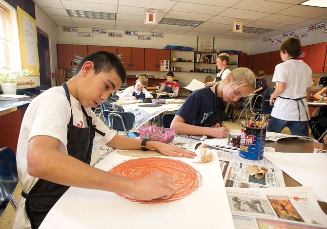 Seventh-grader Eber Munoz works on a sunflower oil-pastel project Wednesday during Susanmarie Oddo's art class at Steamboat Springs Middle School. Oddo's students from the first quarter have examples of their work, including the sunflower project, hanging in Ciao Gelato this month as part of a fundraiser for school art programs.
