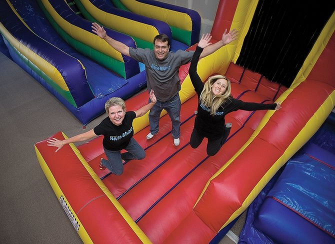 From left, Michelle Womack, David Womack and Shannan Brown will host a grand opening at the Steamboat House of Bounce at 11 a.m. Saturday. The 4,500-square-foot indoor recreational facility includes a Velcro wall, 20-foot double slide, 40-foot obstacle course and a bounce house and slide combination.