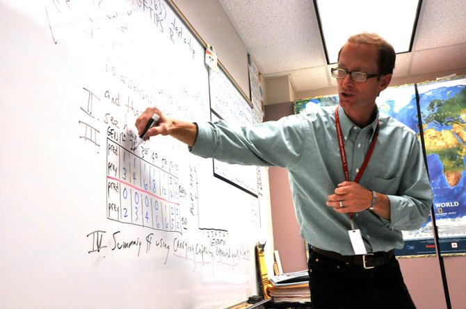 Steamboat Springs High School biology teacher Charlie Leech walks students through a predator and prey diagram Thursday. The Steamboat Springs School District soon will have a new curriculum director who school administrators think will help align curricula across campuses.