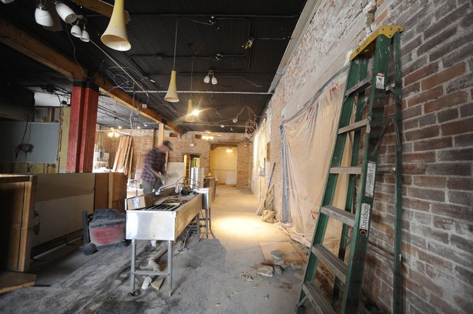 Peter Miller works inside the future home of Rex Brices new restaurant, The Laundry, on 11th Street.
