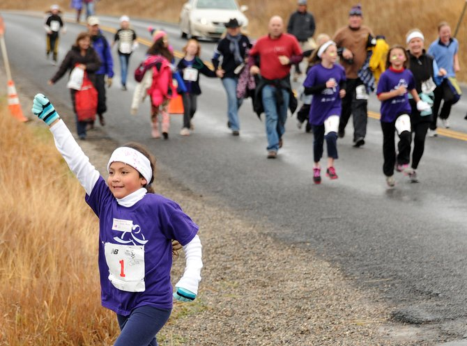 Girls close in on the finish line of Saturday's Girls on the Run event in Steamboat Springs.