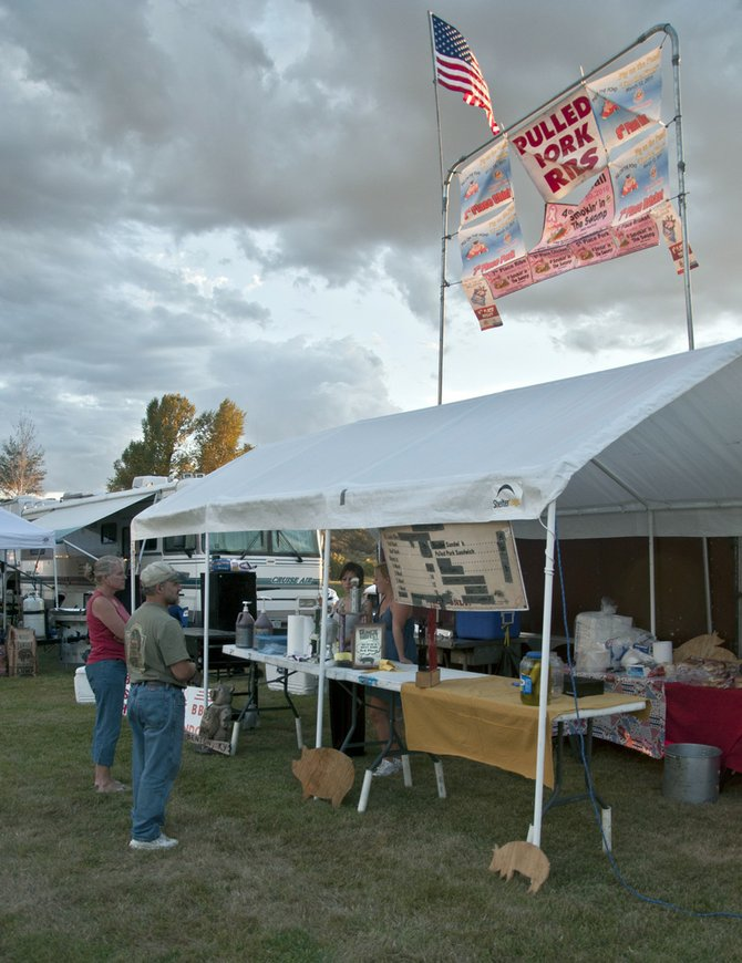 Locals mull over the menu at one of 30 tents at the Colorado State BBQ Championship at Craig held in August at Loudy-Simpson Park. The event was recently recognized by the Rocky Mountain BBQ Association as the best barbecue contest in Colorado.