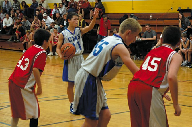 Craig Middle School seventh-grader Eddie Smercina eyeballs his shot before a foul shot during the Bulldogs' Friday game against Steamboat Springs. The CMS seventh-grade A-team beat the Sailors, 21-16.