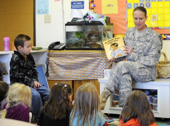 "Tim Bedell, 5, watches his mother, Jennifer Bedell, read ""My Mommy Wears Combat Boots"" to his class Wednesday, when Christian Heritage School recognized Veterans Day. Jennifer Bedell returned to Steamboat Springs in September after a yearlong deployment to Kuwait."