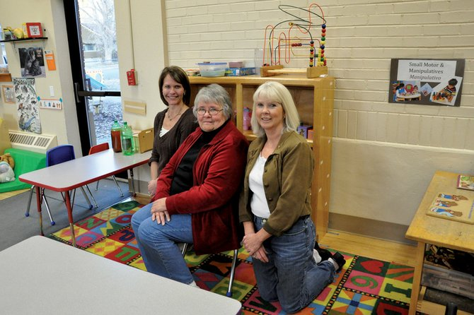 Outgoing Moffat County School Board vice president Andrea Camp, from left, president Jo Ann Baxter and secretary Trish Snyder pose for a photo Wednesday afternoon in the Moffat County Early Childhood Center. During their eight consecutive years on the board, they've overseen major projects in the district, including the construction of a new Craig Middle School and the district's participation in a pilot program for Colorado Senate Bill 10-191, which seeks to establish a consistent statewide educator evaluation system.