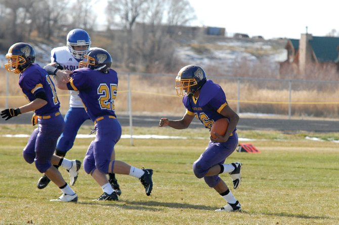 Manuel Quinteros, a Little Snake River Valley School junior, follows behind his blockers Nov. 4 in Baggs, Wyo. The Rattlers' head coach, Mike Bates, said the offense will continue to pound the ball in the Wyoming 1A six-man state championship game today in Laramie, Wyo.