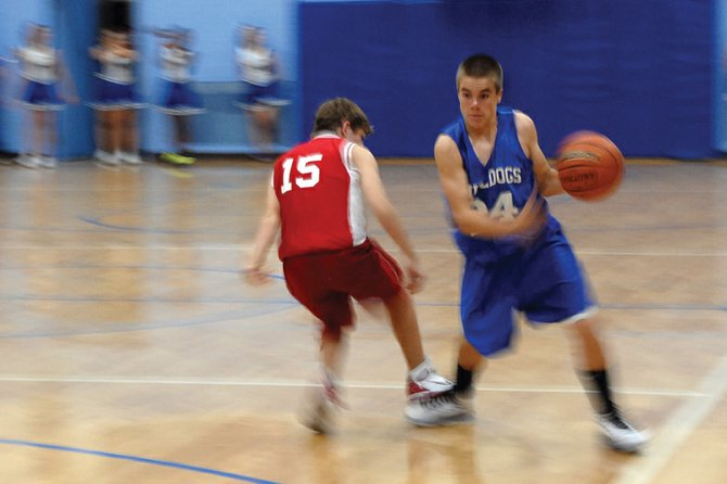 Craig Middle School eighth-grader Ben Robinson drives down court during the Bulldogs' Nov. 8 game with Rawlins, Wyo. Over the weekend, the eighth-grade A-team defeated Soroco, 47-18, and Meeker, 46-18.