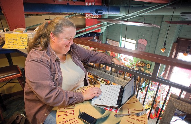 Clark resident Kelley Moss stopped by Off the Beaten Path Bookstore in downtown Steamboat Springs. The members of Ignite Steamboat hope to ask downtown business and property owners to help create a free Wi-Fi zone through downtown.