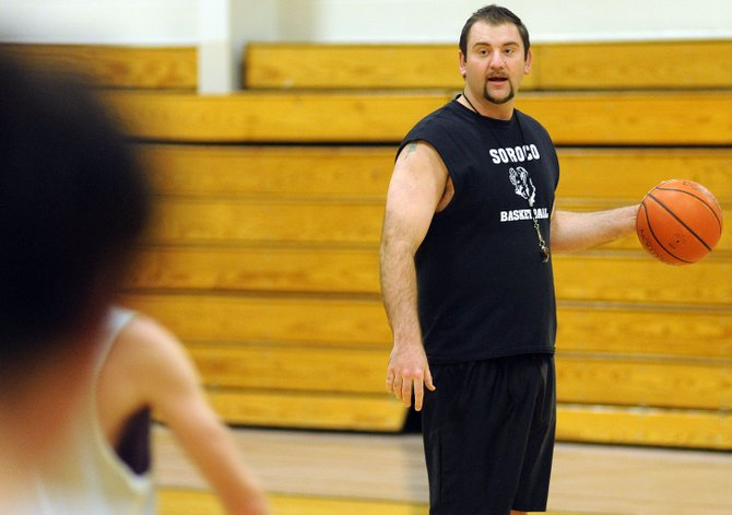 Soroco High School boys basketball coach Sam McLeod runs through an offensive set with his team Wednesday. McLeod is back running the program after missing last season.