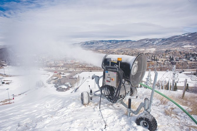 A snow gun at Howelsen Hill blows snow at the downtown ski area Thursday afternoon. Members of the Steamboat Springs Winter Sports Club already have started training on the historic hill, and many locals are hoping the snow-covered slopes soon will be open to the public.
