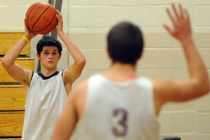 Soroco junior Nic Paxton looks into the lane for sophomore Ryan Jeep on Wednesday during a basketball practice in Oak Creek. The Rams begin their season Dec. 1 at home against North Park.