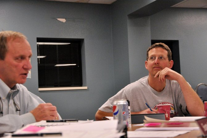 Newly appointed South Routt School Board member Jamie Hoff, right, listens to Superintendent Scott Mader Thursday night at Hoff's first board meeting. Hoff replaced board member Willie Smith, who moved away from the school district in August.