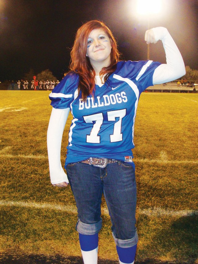 Kelsea DeBowes shows support for her team at a Friday night game.