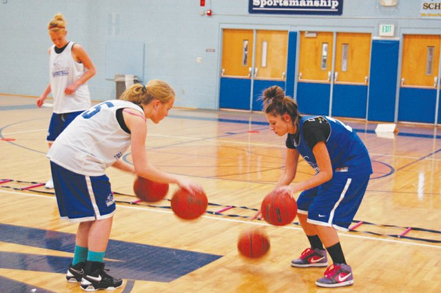 Freshman Brittany Walker, right, practices her dribbling skills in open gym.