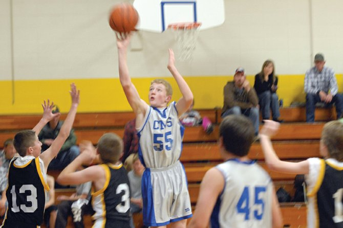 Keenan Hildebrandt, a Craig Middle School seventh-grader, puts up a shot from the outside during the Bulldogs' home game Thursday against Meeker. The CMS seventh-grade A-team won, 47-8.