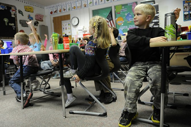 Connor Blunt, 6, joins displaced first-graders in a classroom at the Meeker School District administration building on Oct. 19. A new Meeker Elementary School opened in fall 2010 and is now closed due to structural issues. The elementary school students have been dispersed throughout district buildings including the high school, middle school and administration buildings.