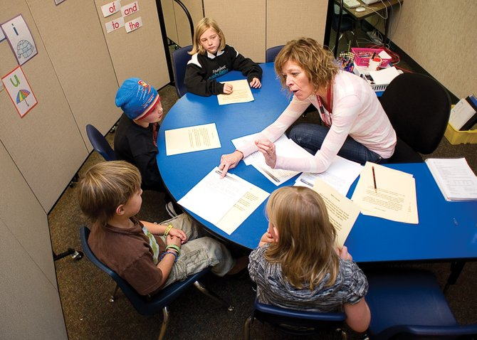 Nancy Hvambsal, a Title 1 reading aid, works with second-graders Monday at Soda Creek Elementary School.  Steamboat Springs, South Routt and Hayden school districts are applying for a $150,00 grant from Mile High United Way that would bring more literacy coaches into each of the county's elementary schools.