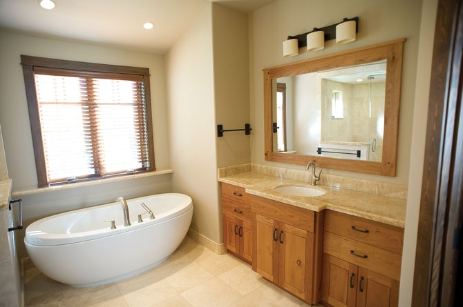 An easy way to dress up a bathroom is with up-to-date tubs, faucets, cabinets and light fixtures. This home in Boulder Ridge features the latest in home designs give the bathroom a unique, modern feel.