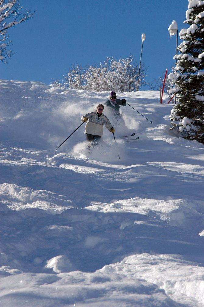 Former U.S. Ski Team member Heidi Bowes, front, and her sister Sue Rife make tracks in their backyard stash, within earshot of the dinner bell.