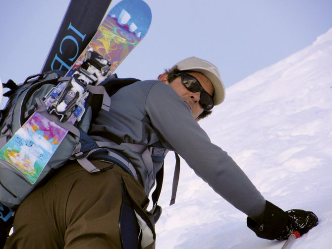 Elevator Going Up: Editor Eugene Buchanan earns his turns on a not-quite backyard bootpack.