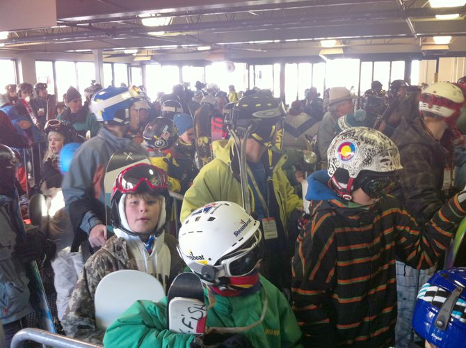 Skiers and snowboarders crowd the gondola loading bay at the Steamboat Ski Area early Wednesday morning for Scholarship Day, the first official day of skiing for the 2011-12 season.