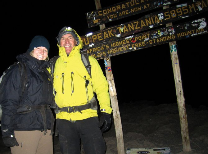 All(titude) in the Family: Ariel Tredway and her dad, Matt, standing atop Africa's Mount Kilimanjaro.