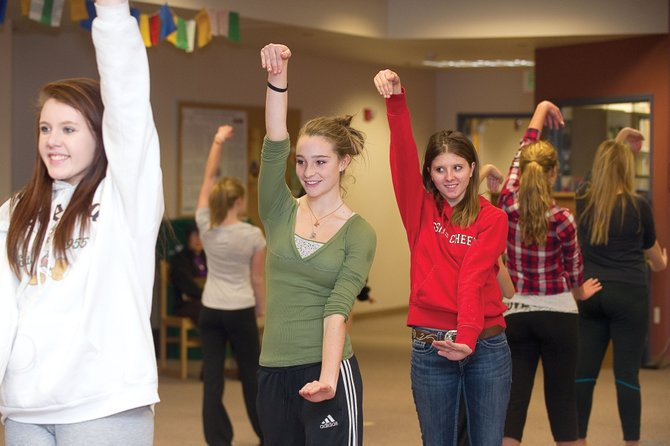Dancer Sage Sullivan, middle, rehearses a routine for the upcoming Dance Showcase on Friday at Steamboat Springs High School. Liz Keen, an instructor at the Perry-Mansfield Performing Arts School and Camp and The Juilliard School, stopped by to help the students with the routine.