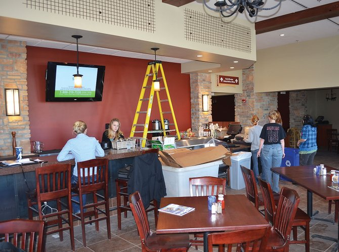 The staff of Three Wire Bar and Grill, the new restaurant at Yampa Valley Regional Airport, was busy Wednesday preparing for the its opening Monday.